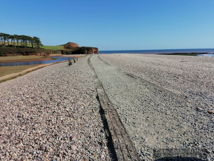 Wide and long stony beach view