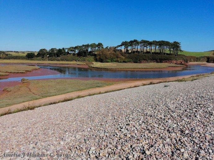 River alongside pebble beach